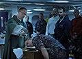 US Navy 100718-N-4973M-050 Chaplain Benton Garrett baptizes Aviation Boatswain's Mate (Fuel) Airman Paul Owen aboard the aircraft carrier USS Abraham Lincoln (CVN 72).jpg