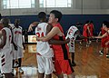US Navy 100825-N-5215E-089 Cryptologic Technician (Technical) 2nd Class Kenneth Booker, assigned to the forward-deployed amphibious assault ship USS Essex (LHD 2), embraces a Japanese player after a basketball game against the.jpg