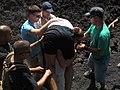 US Navy 110130-N-4437M-011 Lance Cpl. Robert Wrobleski carries a Swiss tourist who collapsed on the Pacaya Volcano near San Juan, Guatemala.jpg