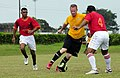US Navy 110605-N-EP471-215 Lt. Joshua Fair, from Canton, Mich., dribbles the ball toward a defender in an exhibition soccer match during a Continui.jpg