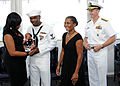 US Navy 110810-N-FC670-017 Vice Chief of Naval Operations (VCNO) Adm. Jonathan Greenert stands with Master-at-Arms 3rd Class Quentin Benjamin and f.jpg