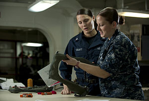 US Navy 111214-N-DR144-177 Aircrew Survival Equipmentman 2nd Class Emilie Mincher inspects LPU-34B-P low-profile floatation collars after a 360-day.jpg