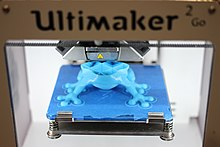 Ultimaker 3D printer printing an object