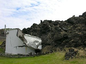Eldfell - A concrete water tank, partly crushed by lava