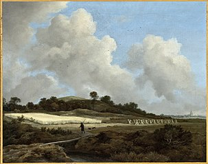 Vue de champ de céréales avec une ville éloignée