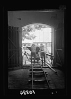 Vintage activities at Richon-le-Zion, Aug. 1939. Pushing trolley across elevated bridge to dump LOC matpc.19783.jpg