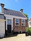 foto van Pastoorshuis Voorm. pastoorshuis (1580-1723: pastorie) (1723-1840: grietenijhuis)