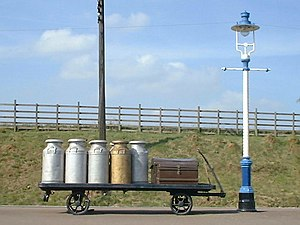 British Railway Milk Tank Wagon - Typical pre-World War I scene of milk churns waiting to be picked up by the milk train, recreated at Quorn and Woodhouse station on the preserved Great Central Railway