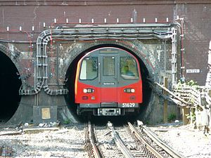 Loading gauge - The clearance between train and tunnel is often small. London Underground train at Hendon Central.