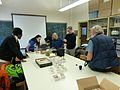 Wikimedians peering at the CUMNH Invertebrate training collections.jpg