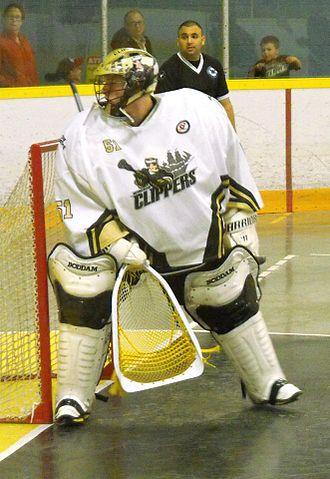 Goaltender (box lacrosse) - Windsor Clippers Jr. B goalie wearing field-style helmet (2014).