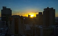 Winter sunrise over downtown Cape Town from roof of Strand South hotel.jpg