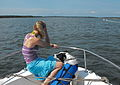 Woman with a dog on a boat-17July2009.jpg