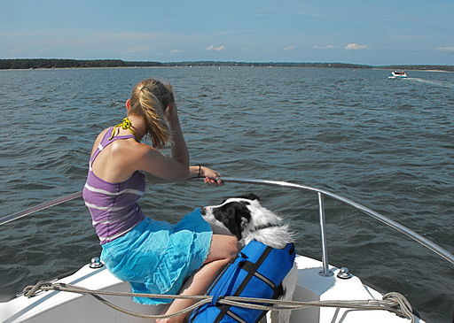 Woman with a dog on a boat-17July2009