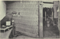Workman operating a guncotton press behind protective rope screen.tiff
