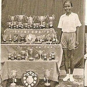 Ila Mitra - Young Mitra with her awards in athletics