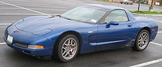 Chevrolet Corvette (C5) - Chevrolet Corvette C5 Z06, with its distinctive black brake duct in front of the rear wheel and fixed-roof coupé body style