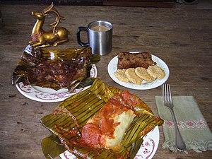 Guatemalan cuisine - Black and red tamales in Guatemala.