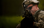 122nd Security Forces Squadron member fires his M249.png