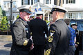 130411-N-ZI511-554 Master Chief Petty Officer of the Navy (MCPON) Mike Stevens speaks with his Australian counterpart, the Australian Warrant Officer of the Navy, Martin Holzberger.jpg