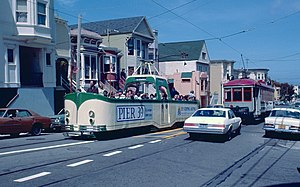 "1983 SF Historic Trolley Festival - Blackpool ""boat"" 226 passing Muni car 1 on 17th St.jpg"