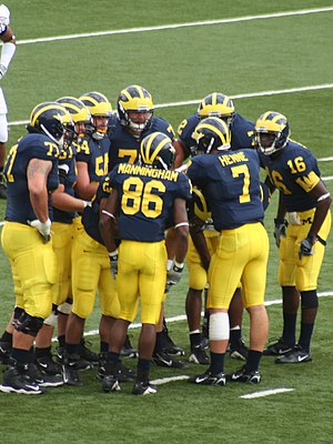 Jake Long - 2006 Michigan Wolverines football team huddle with No. 86 Mario Manningham, No. 7 Chad Henne, No. 16 Adrian Arrington, No. 72 Rueben Riley, No. 54 Mark Bihl, No. 77 Long