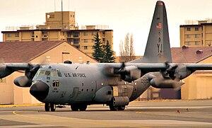 Yokota Air Base - A C-130H Hercules taxis to park on the east side of the flightline at Yokota Air Base, Japan, March 25, 2011.