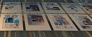Mass media - A panel in the Newseum in Washington, D.C., shows the September 12 headlines in America and around the world.