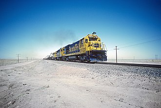 GE B36-7 - AT&SF 7499 between the sidings of Becker and Sais, NM on the Belen Cutoff between Belen and the west end of Abo Canyon in August 1983