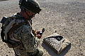 A Georgian soldier with Bravo Company, 31st Light Infantry Battalion shoots an azimuth while observing a notional mortar round at the Joint Multinational Readiness Center in Hohenfels, Germany, Aug. 18, 2013 130818-A-PU716-001.jpg