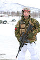A Norwegian military police officer stands guard during a live-fire capabilities demonstration as part of exercise Cold Response 14 in Norway March 11, 2014 140311-M-PK171-614.jpg