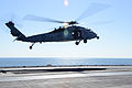 A U.S. Navy MH-60S Seahawk helicopter assigned to Helicopter Sea Combat Squadron (HSC) 7 takes off from the aircraft carrier USS Harry S. Truman (CVN 75) in the Gulf of Oman Nov. 11, 2013 131111-N-MV682-023.jpg