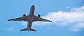 A United 777-200ER departs LAX (9565478735).jpg