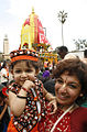 A child and mom at Hindu Jagannath procession in Nairobi.jpg