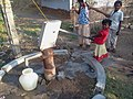 A child pumping water.jpg