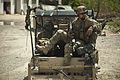 A coalition forces member maintains security from a light tactical all-terrain vehicle during a patrol with Afghan National Army Special Forces to escort an Afghan district governor in Helmand province 130414-M-BO337-123.jpg