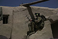 A coalition forces security force member sets up communications equipment during an operation in the Khost district of Khost province, Afghanistan, Aug. 24, 2013 130824-A-HD451-093.jpg