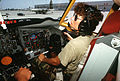 A ground crew member sits in the co-pilot's seat of a KC-135 Stratotanker aircraft as she helps conduct a maintenance check during Operation Desert Shield DF-ST-91-08793.jpg