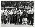 A large group of boys hold baseball and basketball trophies with Satch Sanders of the Boston Celtics (right) (12461579445).jpg