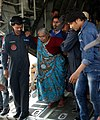 A rescued old woman from Nepal is being de-boarded at Palam Airport from a Transport Aircraft by Indian Air Force officials on April 28, 2015 (1).jpg