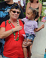 A woman holds her right hand over her heart while attending Key West's annual Veterans Day parade along Duval Street in downtown Key West, Fla., Nov. 11, 2013 131111-N-YB753-253.jpg
