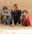A young boy makes funny faces at passing U.S. Army Soldiers, as two others look on, in Talukan village, in Kandahar province, Afghanistan, Oct. 19, 2011 111019-A-CU451-005.jpg