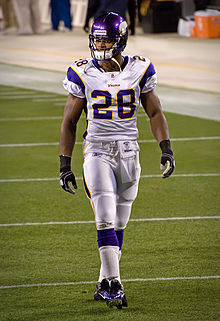 Peterson in full uniform walking on the field