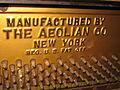Aeolian Player Piano (No. 27934) iron plate - logo & tuning pins.jpg