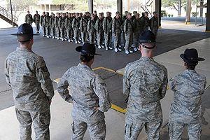 English: Four military training instructors ke...