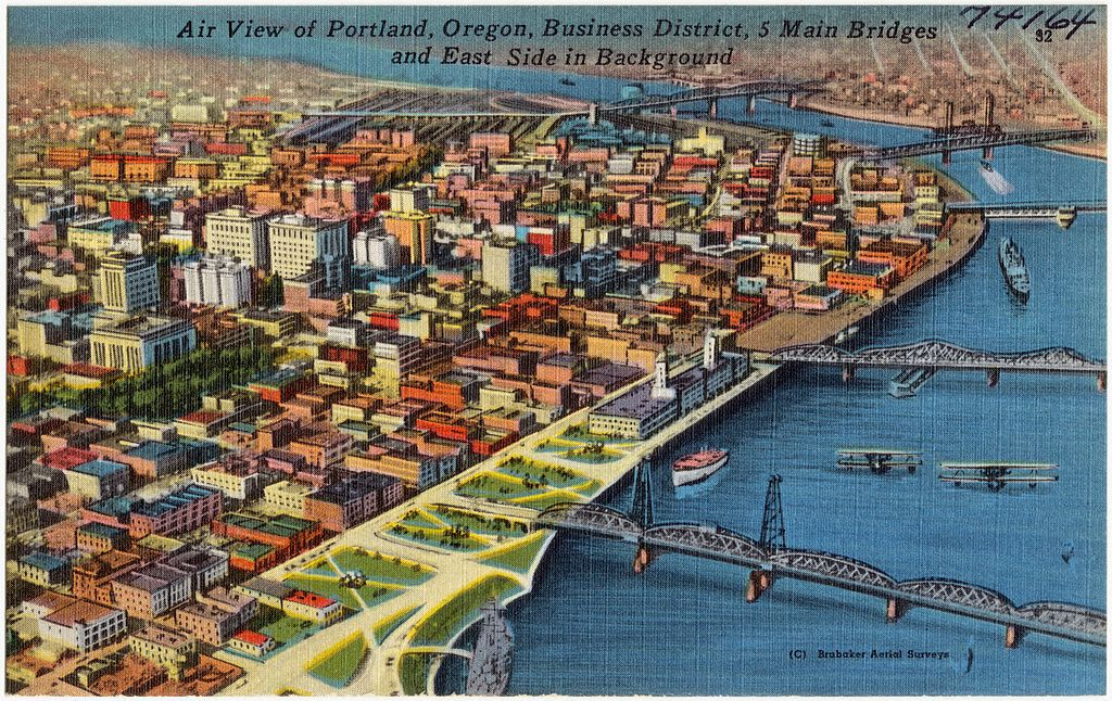 Air view of Portland, Oregon, Business District, 5 main bridges and east side in background (74164)
