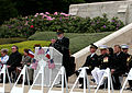 Aisne-Marne American Cemetery and Memorial Superintendent David M. Atkinson, at lectern, addresses U.S. Marines, French service members and guests during a Memorial Day ceremony at the cemetery May 26, 2013 130526-M-XI134-004.jpg