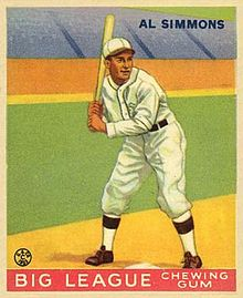 A baseball card picturing Al Simmons batting in a white uniform