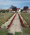 Albert Wass memorial stone, floral beds, 2018 Mezőkövesd.jpg