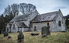 Alnham, Northumberland, England - church of St Michael from the SE.jpg